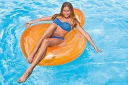 woman on pillow back lounger - orange