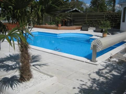 Covrex slatted swimming pool cover rolled up
