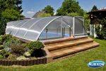 Klasik pool enclosure on a raised pool surround