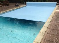 covers slatted pool cover system in use
